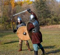 Two warriors in old Russian armors reconstructed medieval fight Stock Photos