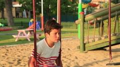 Sad little boy at the playground Stock Footage
