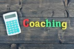 Coaching on wooden table Stock Photos