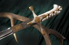 Ancient sabre on white Stock Photos