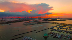 AERIAL - Sunset - AMAZING RED SKY - Dusk in South Beach looking into Miami sk Stock Footage