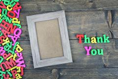 Thank you on wooden table Stock Photos