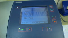 Display of laboratory equipment for milk analysis. Screen with analysis results Stock Footage