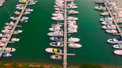 AERIAL - Sunset - Amazing view of boats and bay Stock Footage