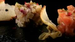 Fish tartare with crisp bread, closeup Stock Footage
