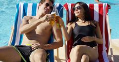 Attractive young couple enjoying a beer Stock Photos