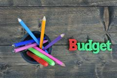 Budget on wooden table Stock Photos