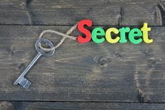 Secret on wooden table Stock Photos