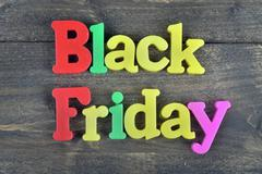 Black friday on wooden table Stock Photos