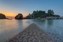 Isola Bella in Sicily at dusk - stock photo