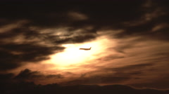 Airplane Flying Through Ominous Sky Stock Footage