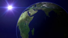 Big earth rotating globe with small but shiny sun - Animation background loop Stock Footage