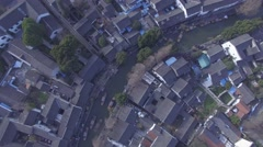 Aerial shot push in to old watertown with river in China Stock Footage