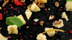Restaurant food, cheese platter on the black stone tray, loop Stock Footage