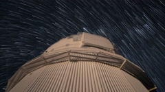 Star Trails turning over observatory time lapse, Mauna Kea, Big Island, Hawaii Stock Footage