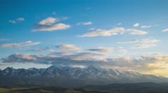 Kurai steppe and North Chuya ridge at the dawn. Clouds and Mountains Stock Footage