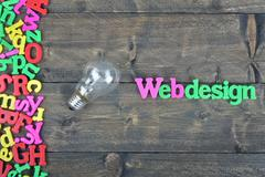 Webdesign on wooden table Stock Photos