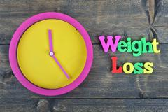 Weight loss on wooden table Stock Photos