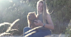 Young adult female taking selfie with dog Stock Footage