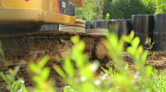 Yellow excavator on a construction site going Stock Footage