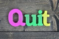 Quit on wooden table Stock Photos