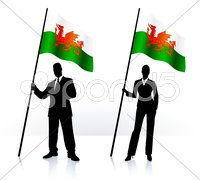 Business silhouettes with waving flag of Wales Stock Illustration