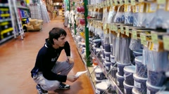 Young man chooses construction materials in the store. Stock Footage