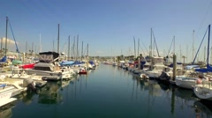 Drone view of boats in harbor on sunny day Stock Footage