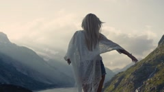 Athletic girl is dancing on the top of the world, beautiful mountains Stock Footage