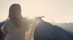 Girl is dancing, bright sunshine and amazing nature around Stock Footage