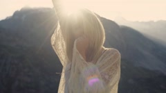 A model is dancing on the bright sunshine in the mountains. Stock Footage