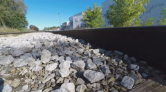 Extreme Closeup of Rail and Stones on Railroad Tracks, While Walking Stock Footage