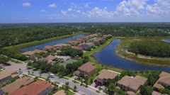 Aerial drone footage upscale residential neighborhood Stock Footage
