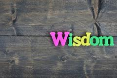 Wisdom on wooden table Stock Photos