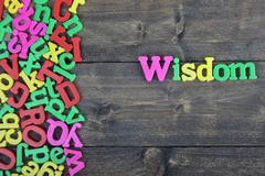 Wisdom on wooden table Stock Photos