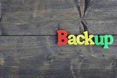 Backup on wooden table Stock Photos