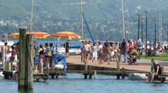 Tourist walking at the lake of Annecy France Stock Footage