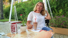 Woman drinking frappe in cafe Stock Footage