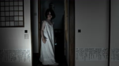 4k Halloween Shot of a Child Appearing in the door from darkness Stock Footage