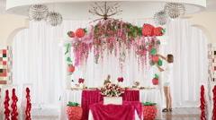 Girl florist decorates the Wedding Hall Stock Footage