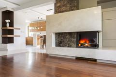 Warmth and luxury of an elegant fireplace Stock Photos