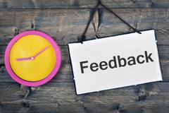 Feedback sign on wooden table Stock Photos