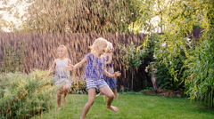 Group of carefree cheerful children playing in the garden. Running around Stock Footage
