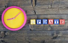 Clock and word Update Stock Photos