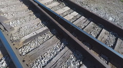 Closeup of Rails, while Walking on Railroad Tracks Stock Footage