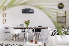 Simple and clear dining room with a scent of exoticism Stock Photos