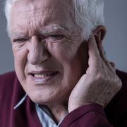 Man with earache Stock Photos