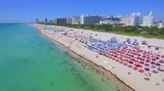 People sunbathing on the beach Stock Footage