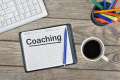 Coaching message on notebook Stock Photos
