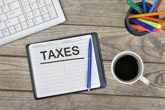 Taxes message on notebook Stock Photos